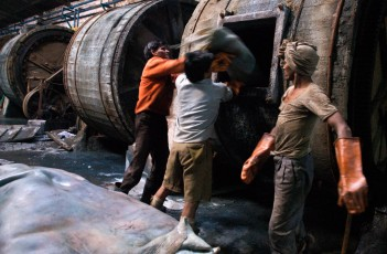 FINAL for Consilience Workers at one of Kanpur's four hundred tanneries, the city's primary industry, load hides into well-used tumblers. Treating leather in this manner is a multi-step process requiring chemicals such as chronium and copious amounts of water. After the water is used, and thus highly polluted to human and animal use, it is more often than not piped back to the Ganges without any treatment. DRAFT Workers at one of Kanpur's 400 tanneries, its primary industry, load hides into well-used tumblers. Treating leather is a multi-step process often requiring exposure to chemicals such as chronium, Y, and Z. At the same time, however, - working at the tanneries offers a better wage than working as a farmer. What is the average wage in India? What is the wage at the tanneries? How many people have migrated from the country to the cities? What effect has this had on India? Growth rate? Slums? Overpopulation?? What are the effects of these chemicals from tanning leather? Are these chemicals allowed in the US? What other kinds of jobs do Indians do that are dangerous? Where do these hides go? Are they exported to the U.S. ??? If so maybe you could even take a picture of someone wearing one, that would really bring the connection home Location: - Links: -