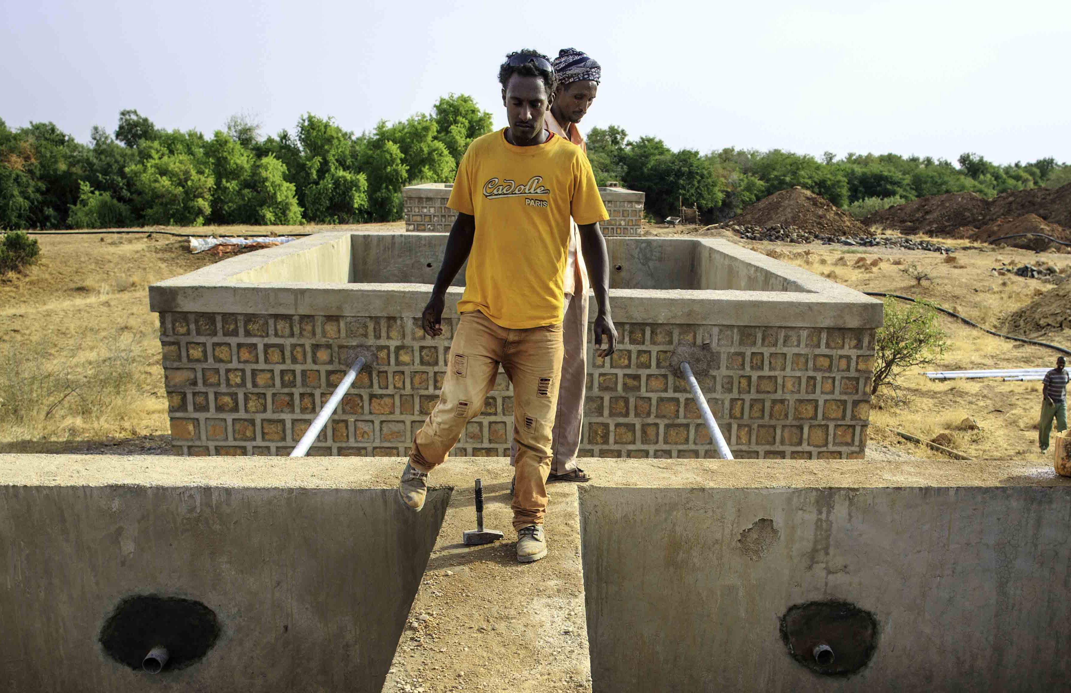 Filtering tanks are filled with gravels inside one of 3 filtering tanks of a river intake construction by Shebele River in Yahas-Jamal Kebele in Somali region of Ethiopia 11 February 2014. In Somali Region water supply coverage is estimated at 59.7%, lower than the national average of 68.5%. The need for water supply normally increases in the dry season, especially at the time of drought such as in recent years. However, the technical and organizational capacity of the Somali Regional State Water Resources Development Bureau (SRWDB) the government agency responsible for water supply and facilities management in the region to satisfy the water supply need is not adequate to cope with the situation. Donor agencies and NGOs are making efforts to ameliorate the situation by constructing and repairing water supply facilities across the region, supplying water by water trucks during chronic shortages, but the supply is still significantly below the demand.