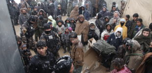 Villagers from the Charahi Qambar refugee camp stand in the cold on Feb 11, 2012. The villagers stand waiting for clothes and blankets that where being distributed by International Security Assistance Force members due to the harsh winter in Kabul, Afghanistan.(U.S. Army photo by Spc. Anthony Murray Jr.)