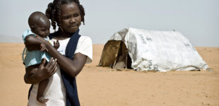 A young girl in Sudan holding a baby near a USAID tent in the Al Salam IDP (Internally Displace Persons) camp. Photo credit: Sven Torfinn